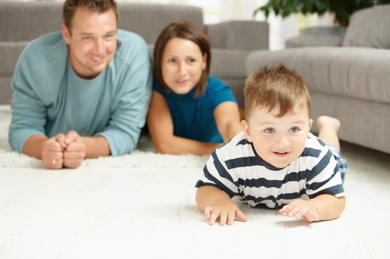 bigstock-Happy-family-lying-on-floor-in-13094744-800x533